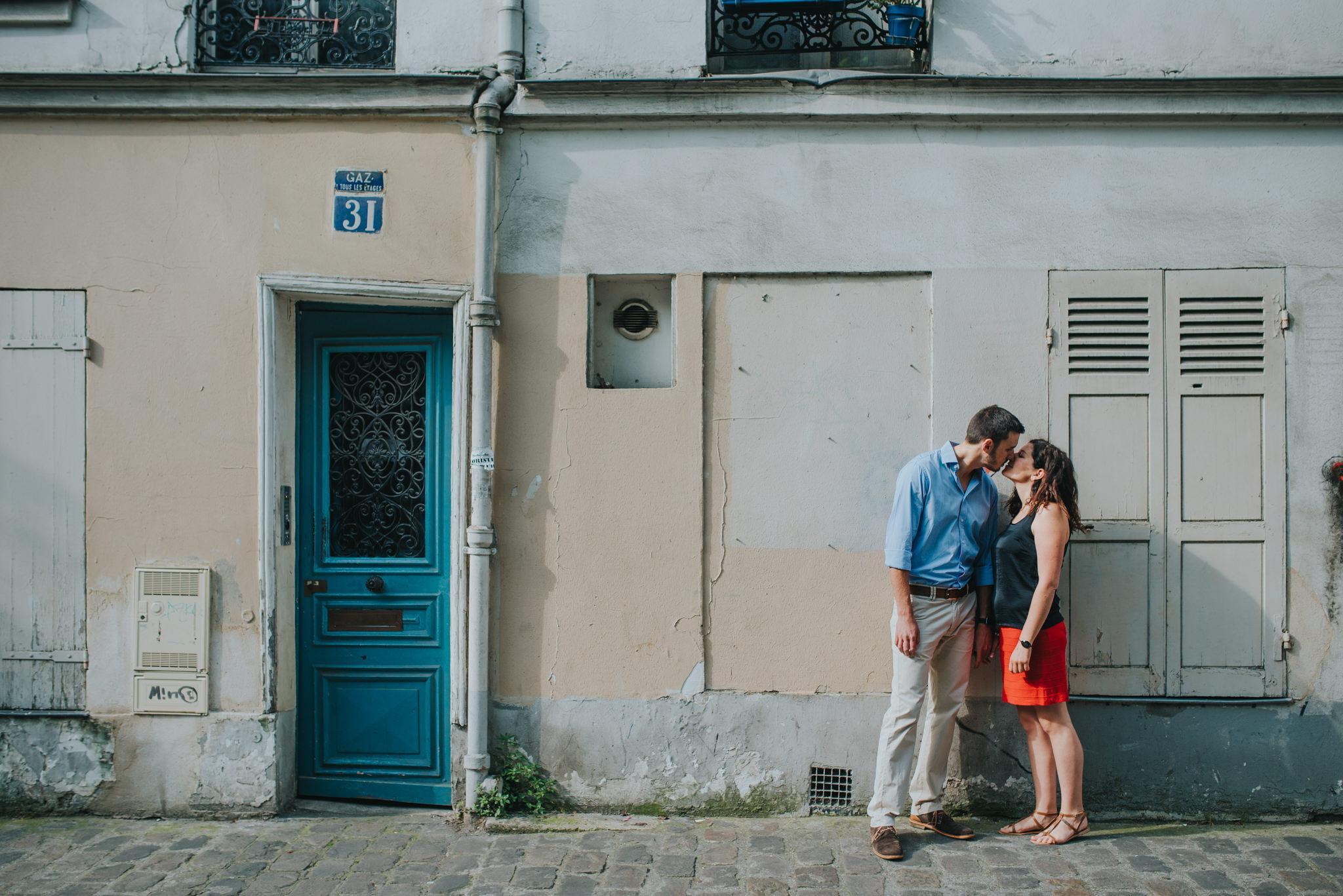 Paris engagement shoot couple in love kissing on Montmartre street