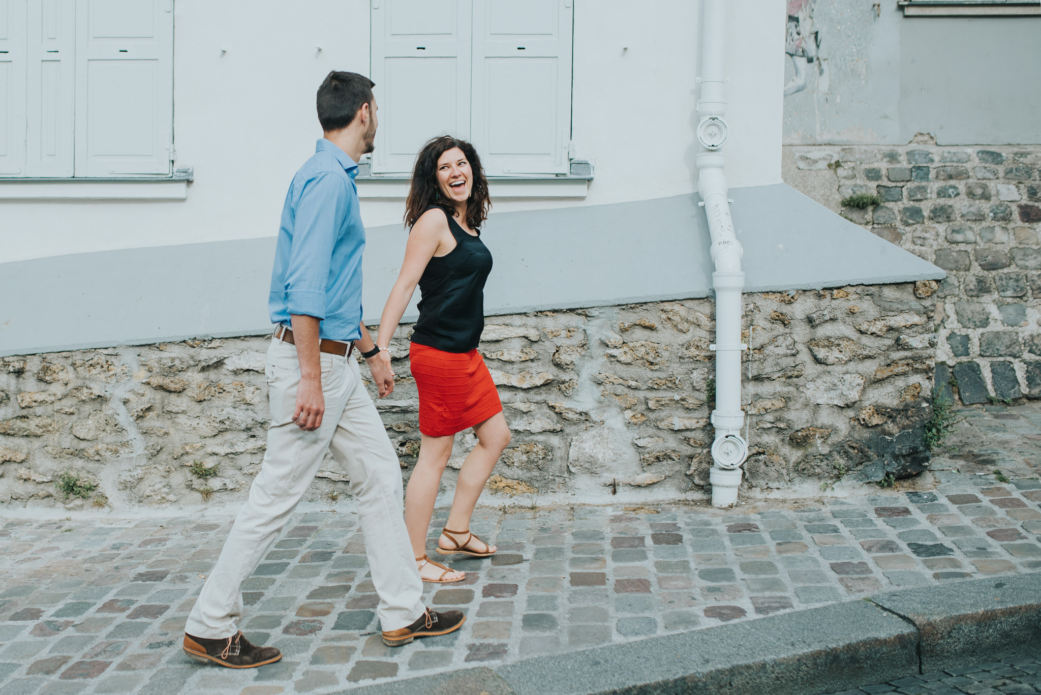 Paris engagement photography couple in love walking on Montmartre street