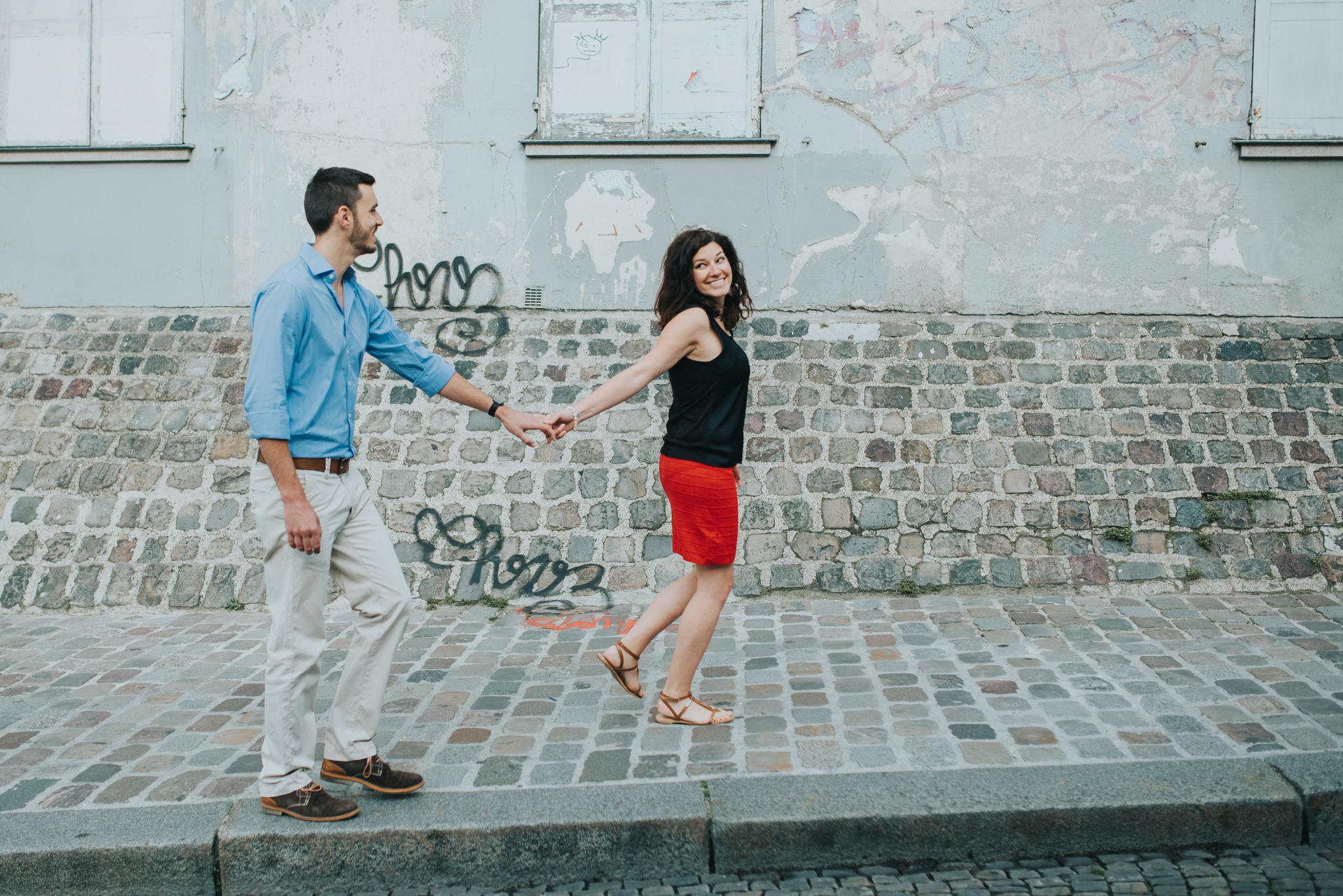 Paris engagement shoot couple in love walking on Montmartre street