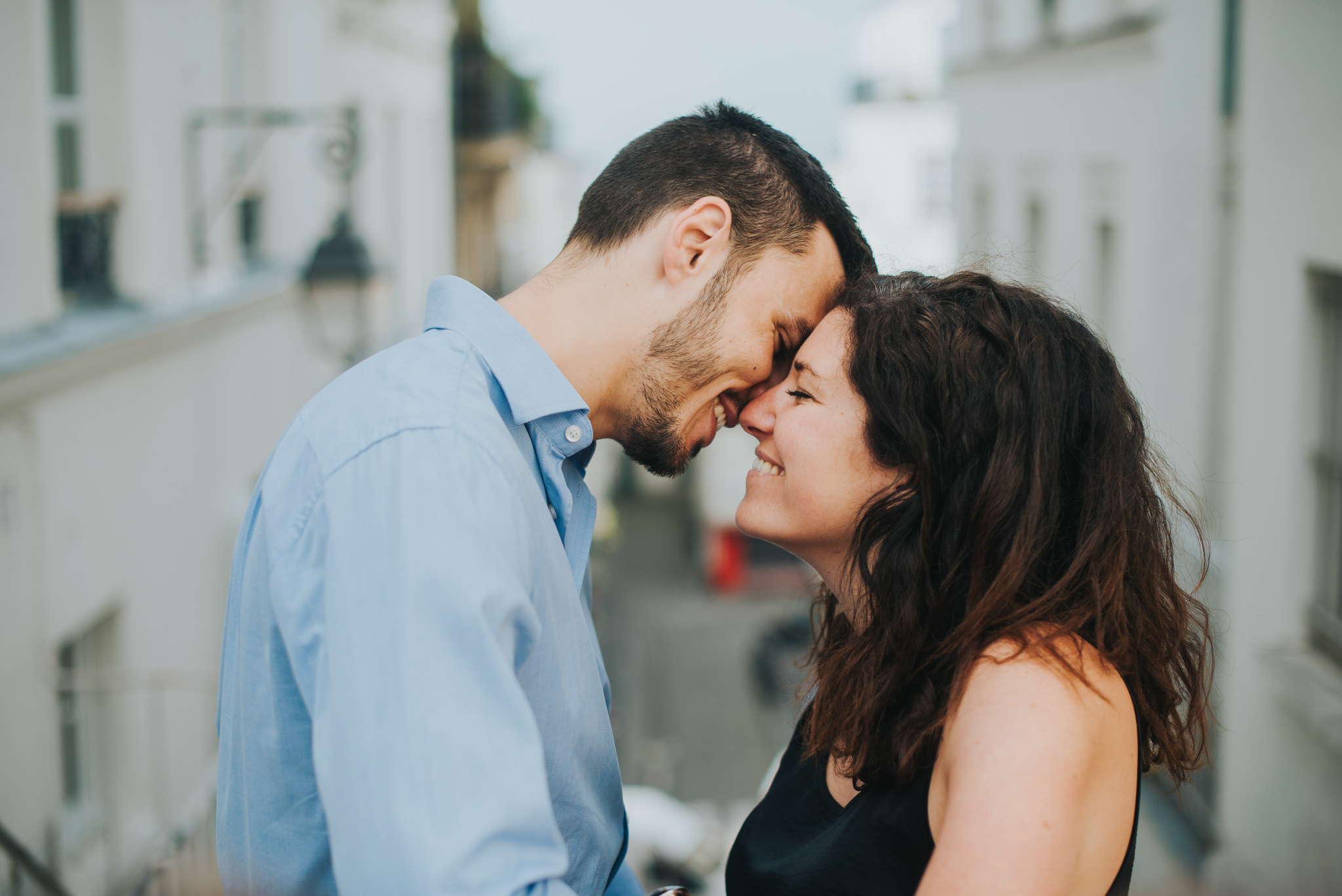 French couple shoot man and woman in love smiling and kissing