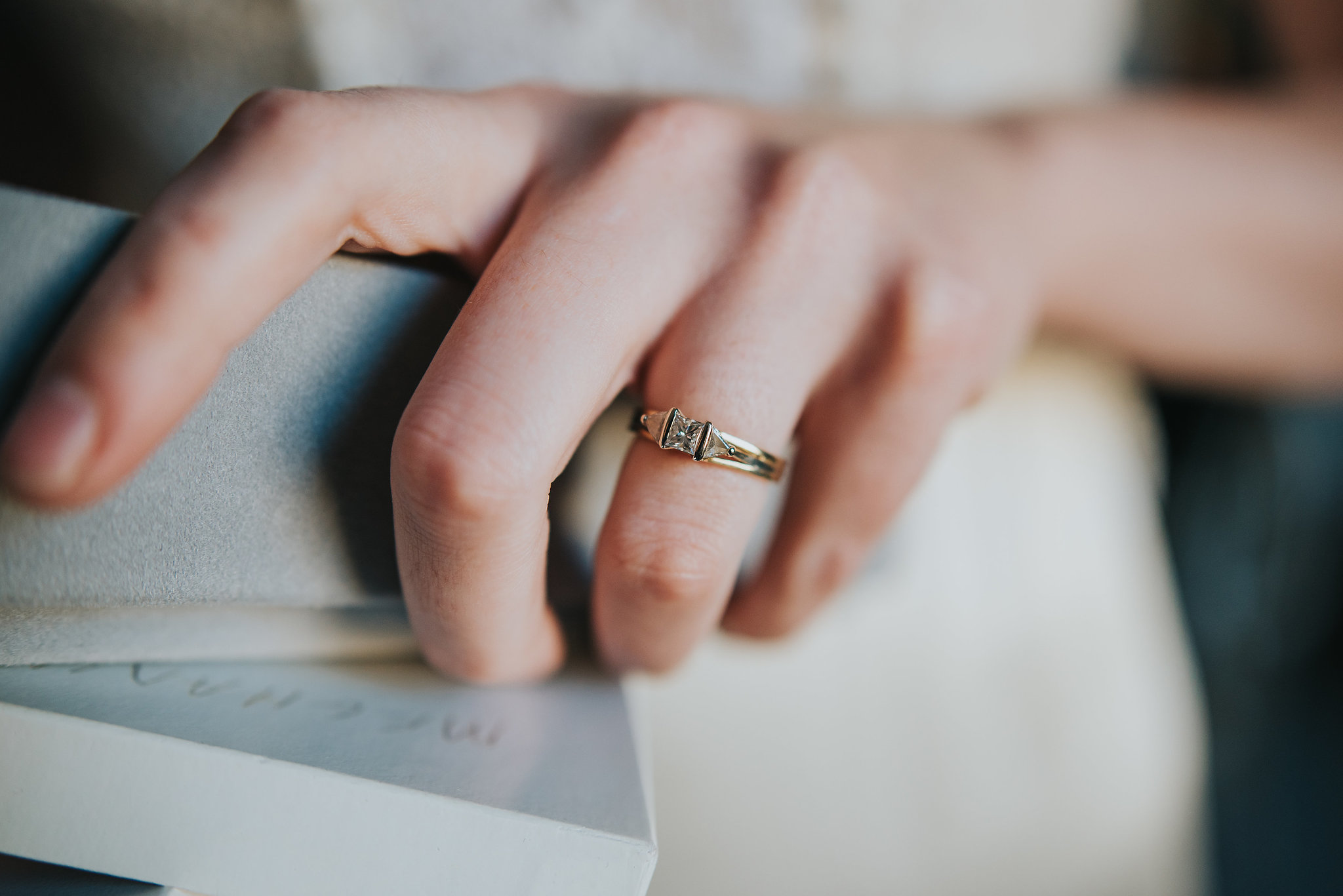 Close up of antique engagement ring on bride's finger