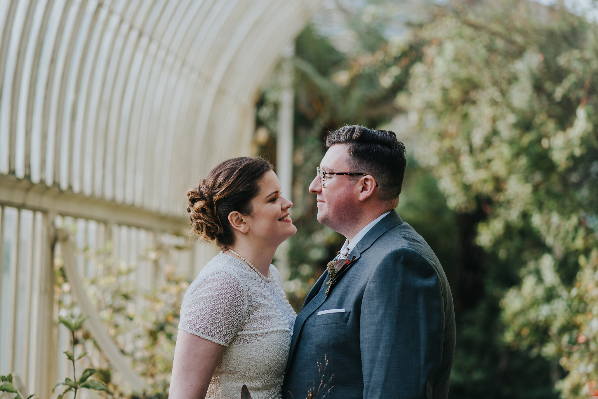 Bride and groom kissing in the greenhouse at the Botanic Gardens in Dublin