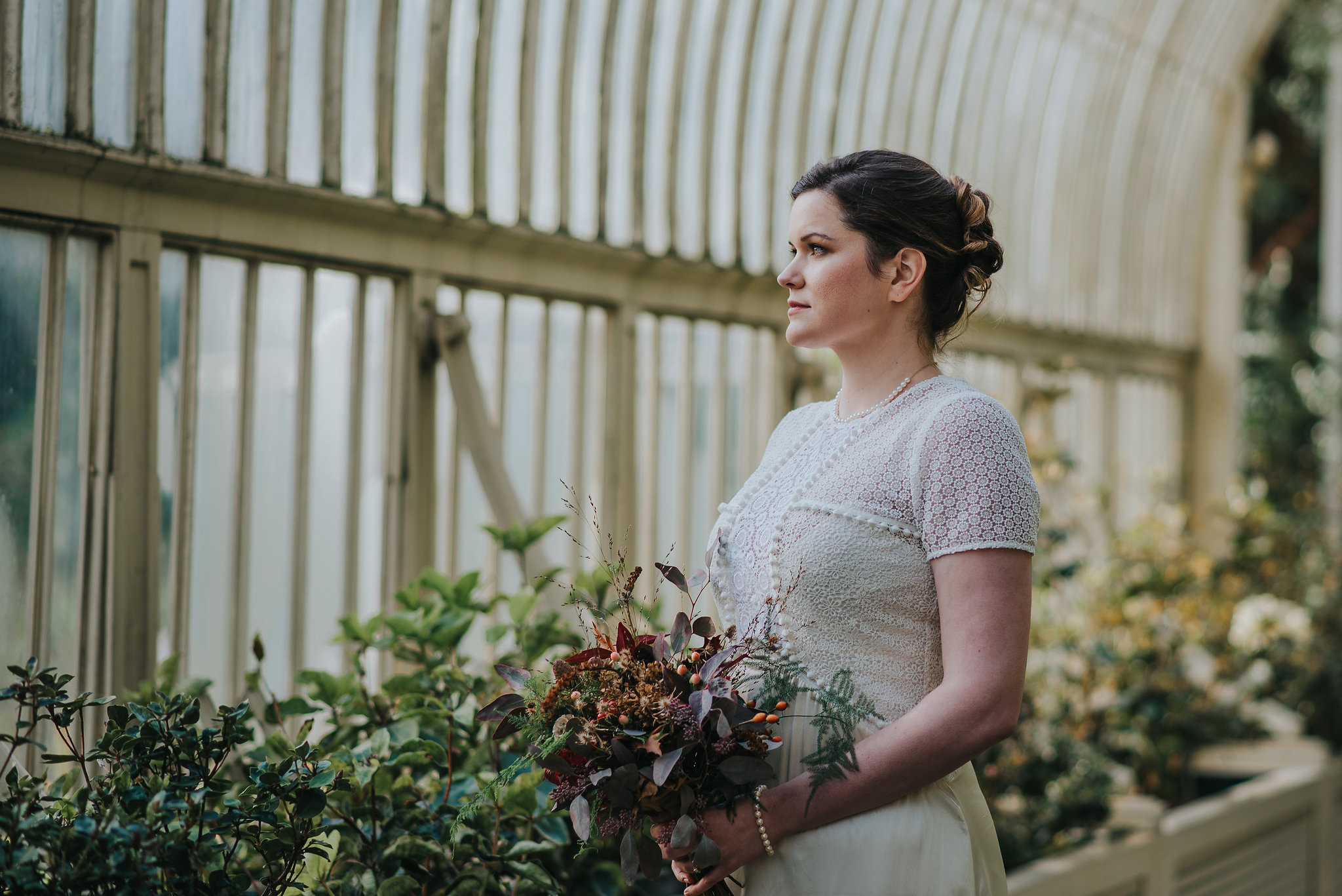 Bride holding bouquet in greenhouse at the Botanic Gardens Dublin on her wedding day