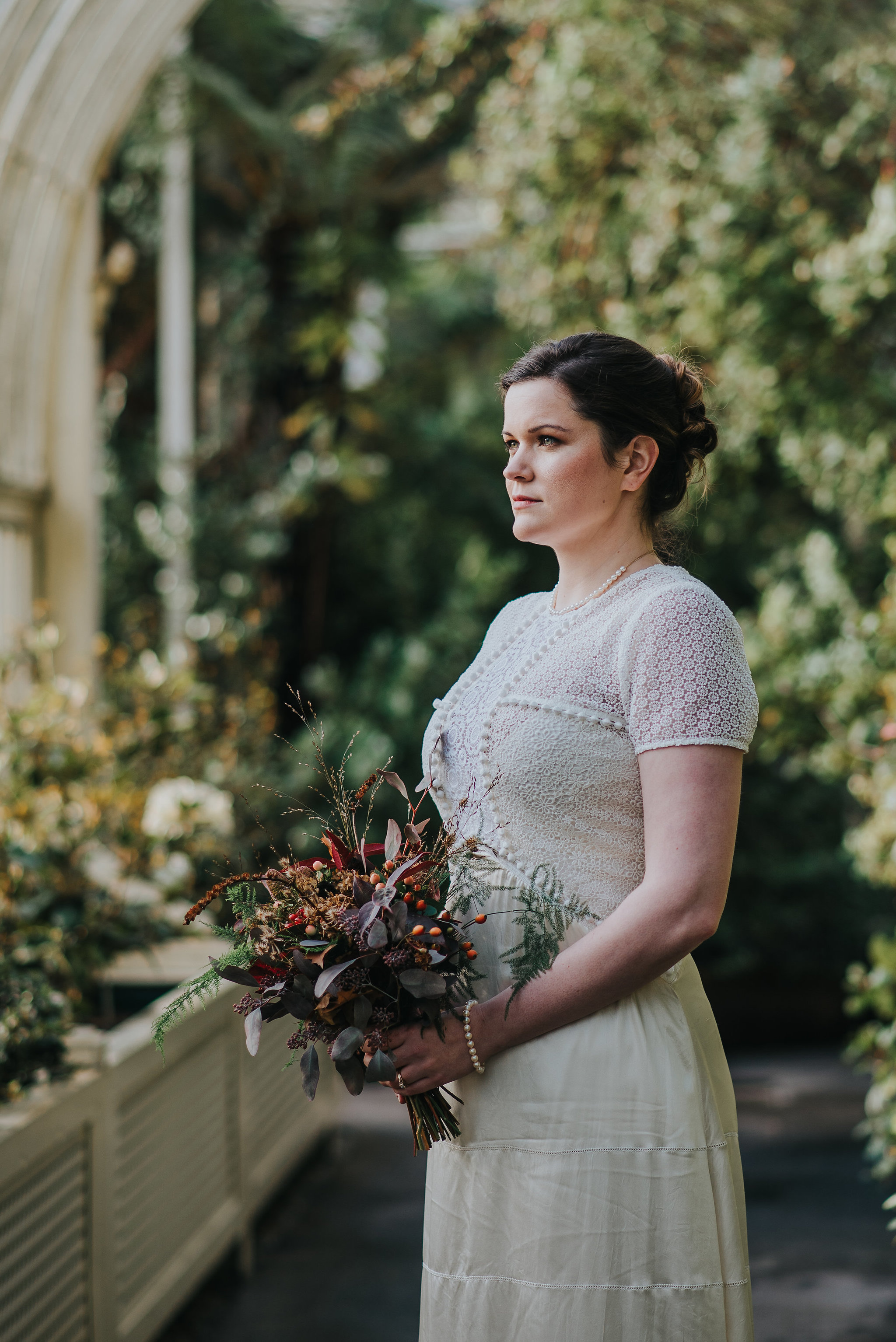 Bride holding flowers on her wedding day at the Botanic Gardens Dublin