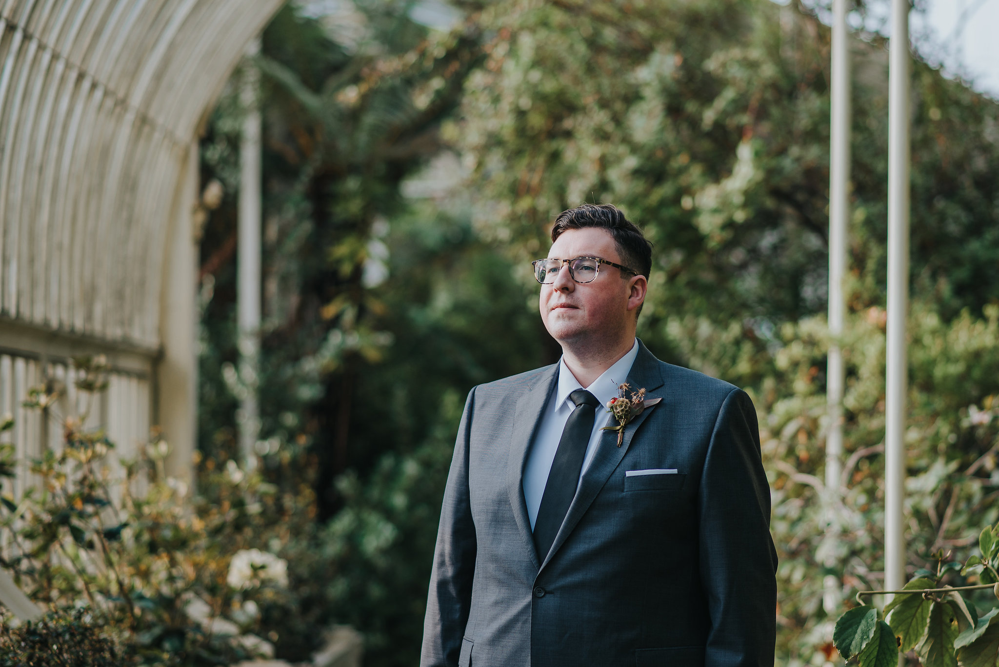 Groom at the Botanic Gardens Dublin on his wedding day