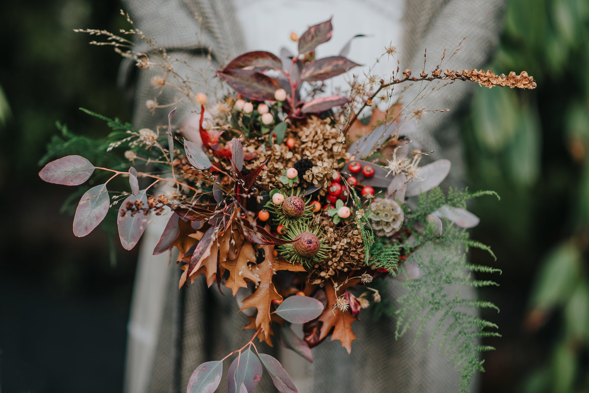 Close up of bridal bouquet with autumn flowers and leaves