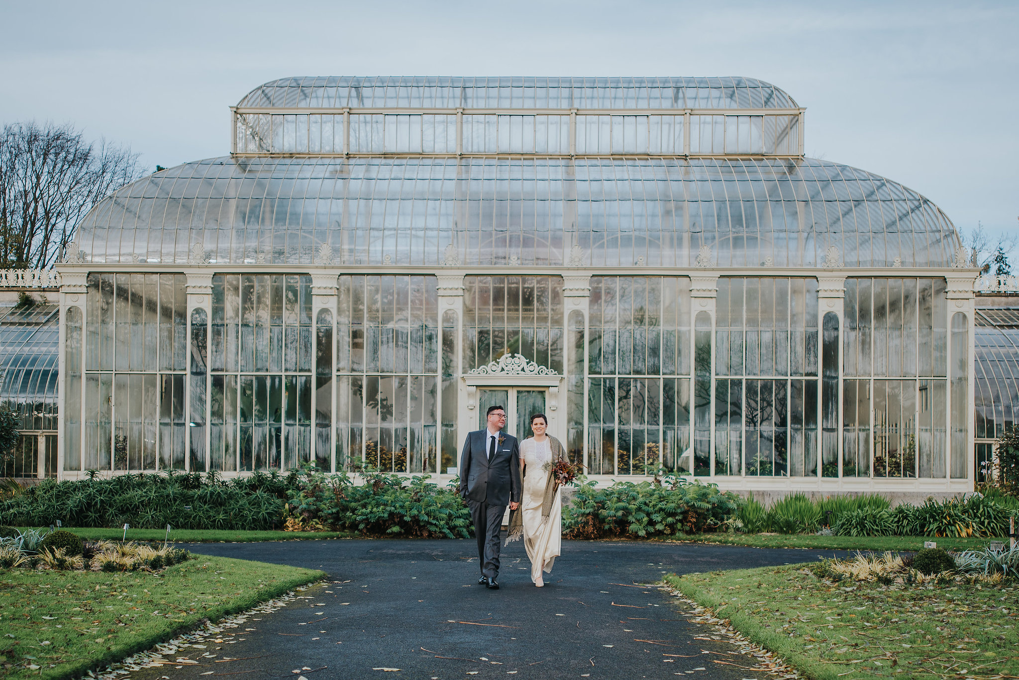 bride and groom walking in the Botanic Gardens Dublin on their wedding day