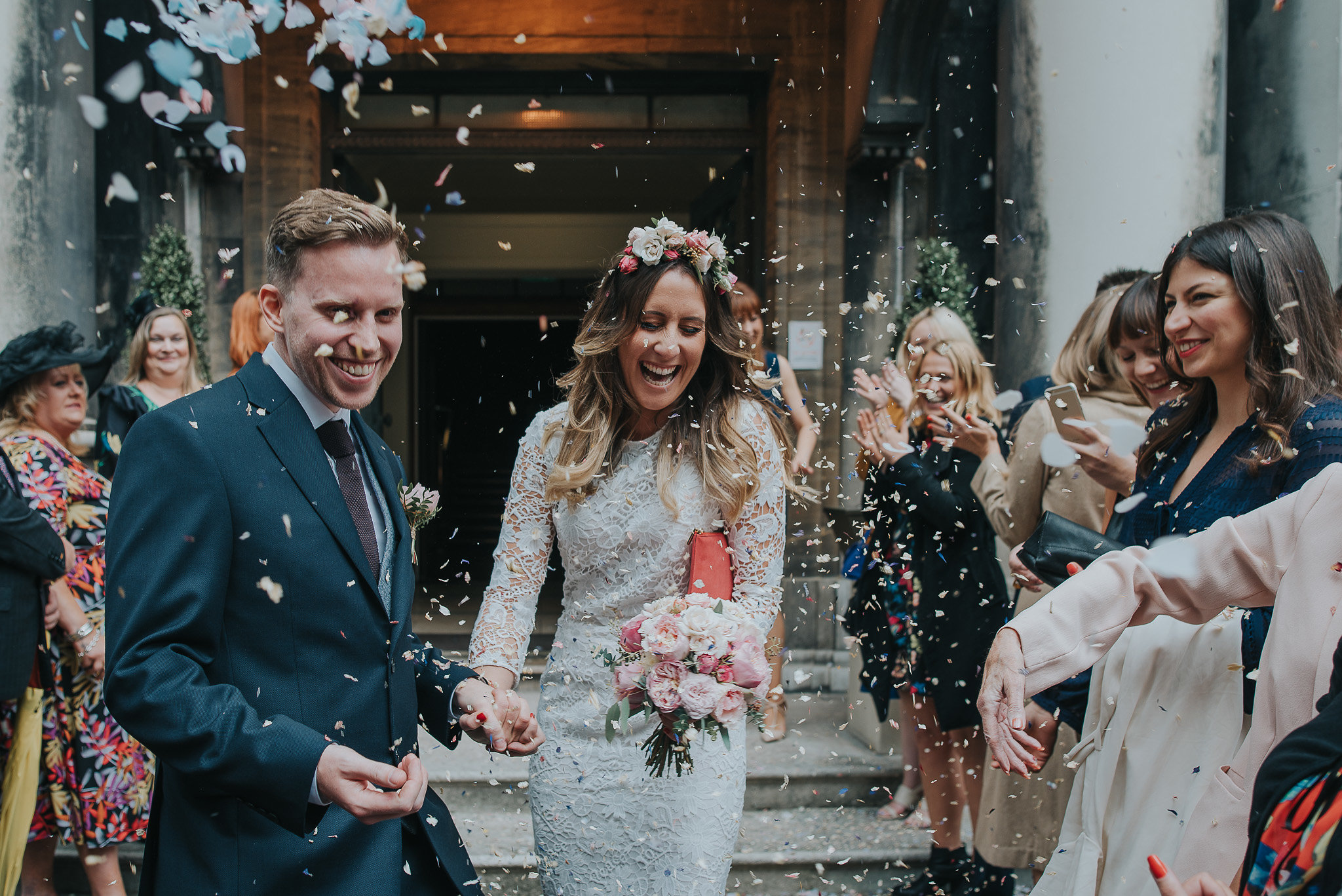 Bride and groom confetti photograph outside Stoke Newington Town Hall