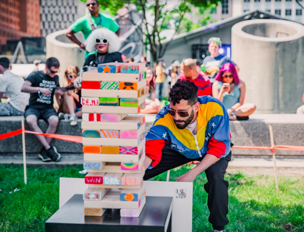 Eli Goldstein of Soul Clap playing Jenga at Movement Festival.
