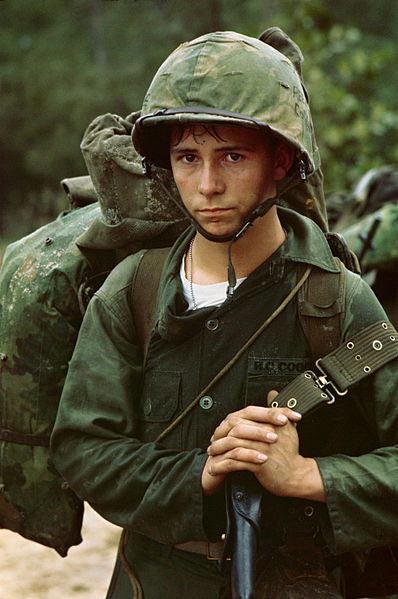 Da Nang, Vietnam - A young Marine private waits on the beach during the Marine landing. - August 3, 1965. Image courtesy of Wikimedia Commons (Public Domain): National Archives and Records Administration (532432).