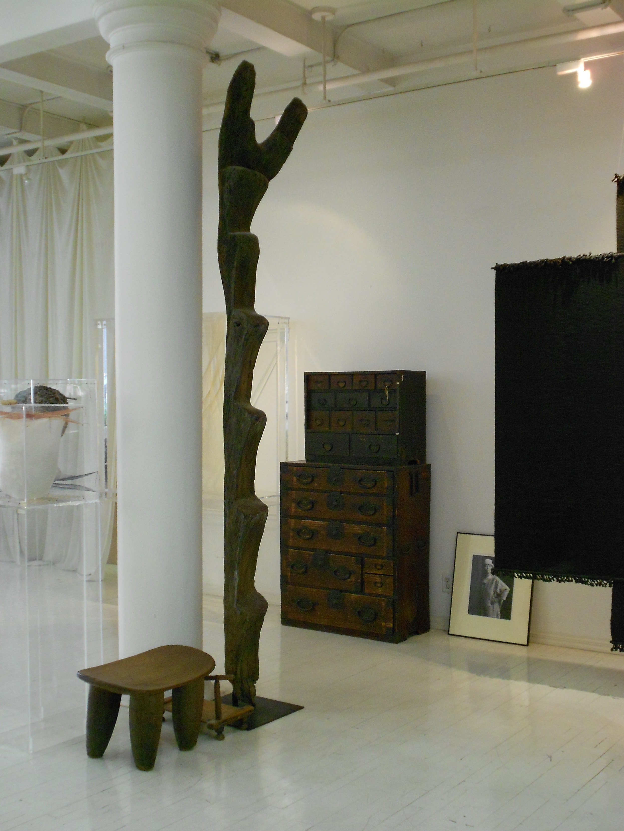 Exotic WOOD furniture from as far as Africa and Japan had a home in  Lenore Tawney's loft.