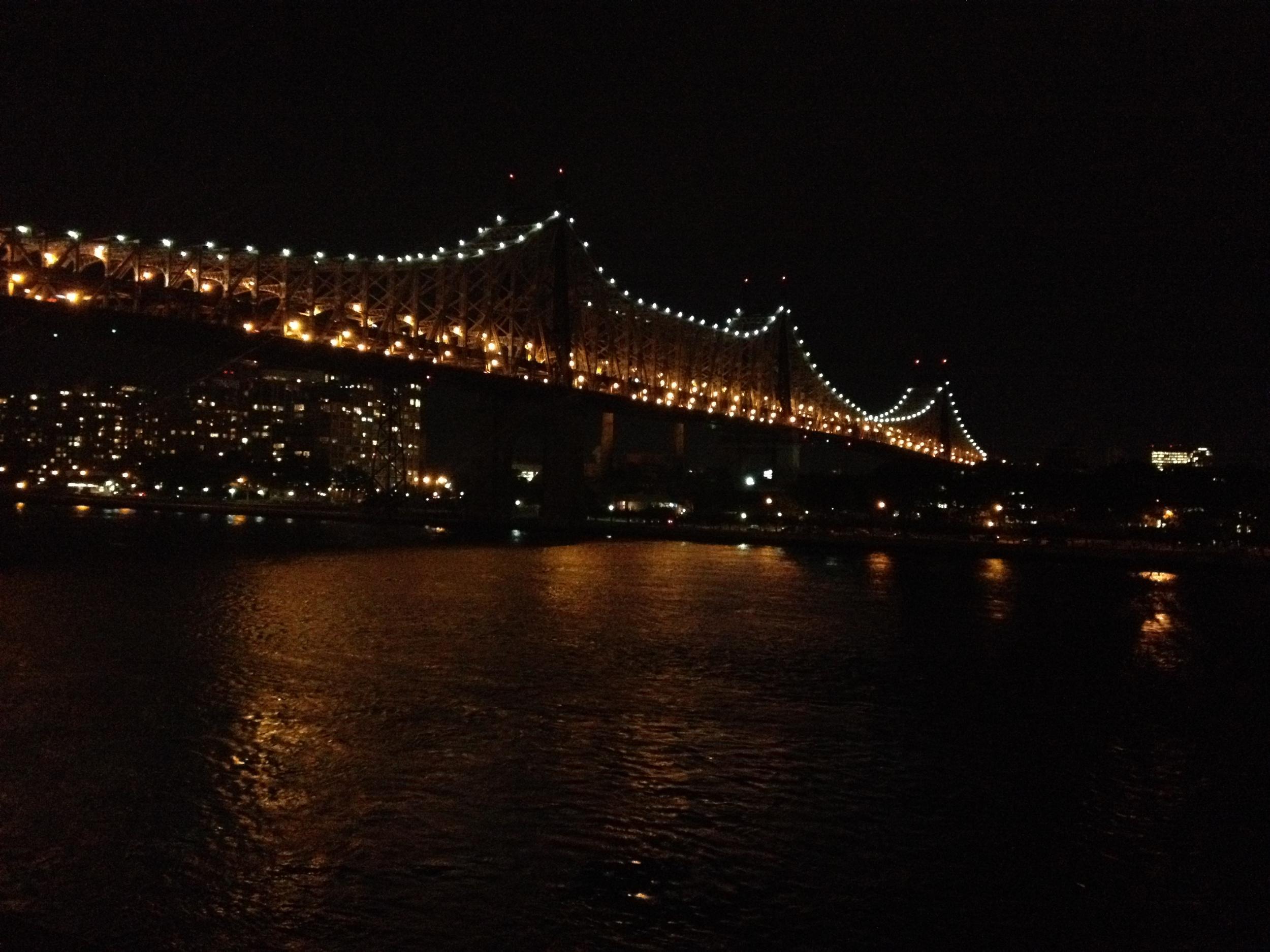 59 St Bridge lit at night
