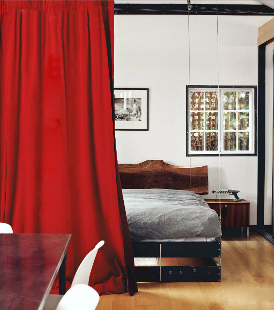 Red curtain room divider