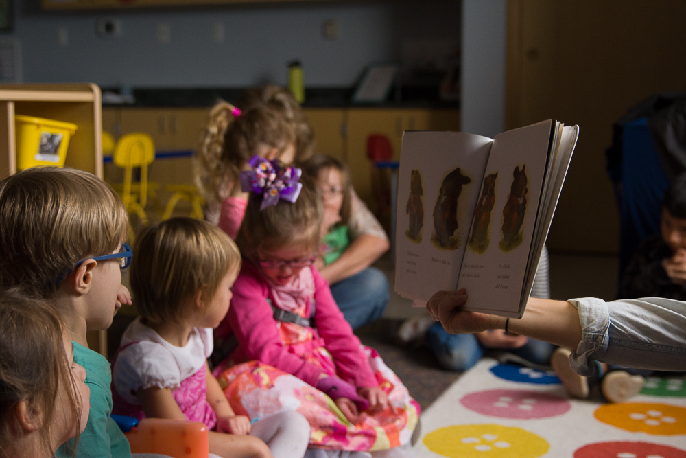 Hearing a story together in low lights helps our preschoolers calm their engines after fun and excitement outside.