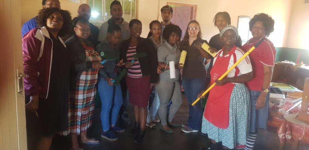RPC Astrapak JJ Precision embraced the opportunity to gather volunteers for a worthy project on Mandela Day, exercising our Core Values of TEAMWORK and RESPECT. Far left:Mrs Lungile Shabangu (Manager of J-Ndwalane (Marianhill) Pre-School), behind her is Zakhele Myeza (JJ Precision General Manager); centre of photo with grey trousers and shirt is Quality Controller Lindiwe Luthuli.  JJ Precision team front from left: Thulile Shabangu; Zanele Nxele; Bongekile Zuma; Ncamisile Ngubane; Lindiwe; Jessica Steyn; Nozipho Chamane; Samkelisiwe Manci; and back from left: Zak Myeza; Marven Geza; Simeon Daniel; Zizipo Moni; Ashton Ranjith; Themba Magcaba.