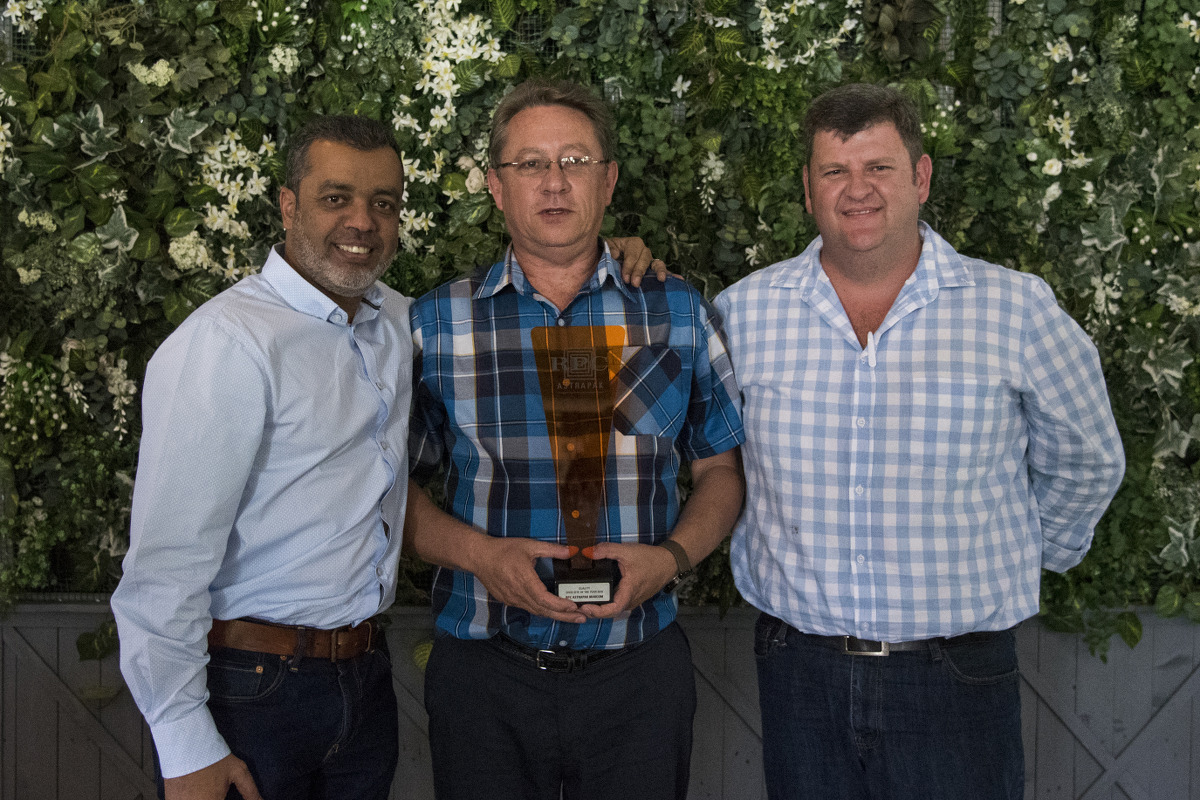 QUALITY: SHEQ Site of the Year → RPC Astrapak Marcom [RPC Astrapak Group Procurement & Supply Executive Nawaaz Kalick awards the trophy to SHEQ Manager Gert van der Berg and General Manager Gerhard van Reenen]