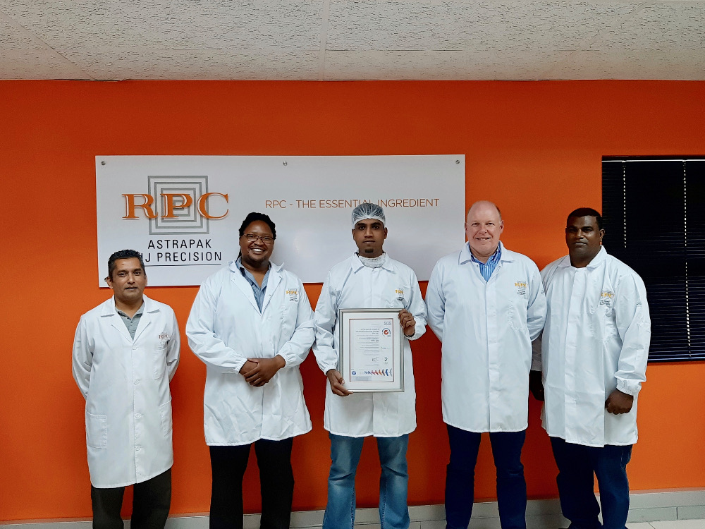 The Team at JJ Precision from left: Nelash Harinarain (Quality Assurance Manager); Zakhele Myeza (General Manager); Ashton Ranjith (Food Safety Coordinator); Robin Moore (RPC Astrapak CEO); Sagren Naicker (Lab Supervisor).