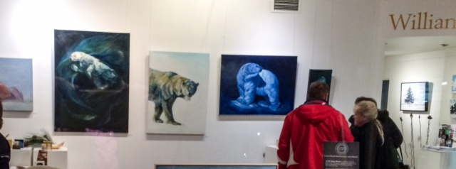 Visitors to the Williams Mill Gallery discussing Christine Montague polar bear paintings.  ©Christine Montague