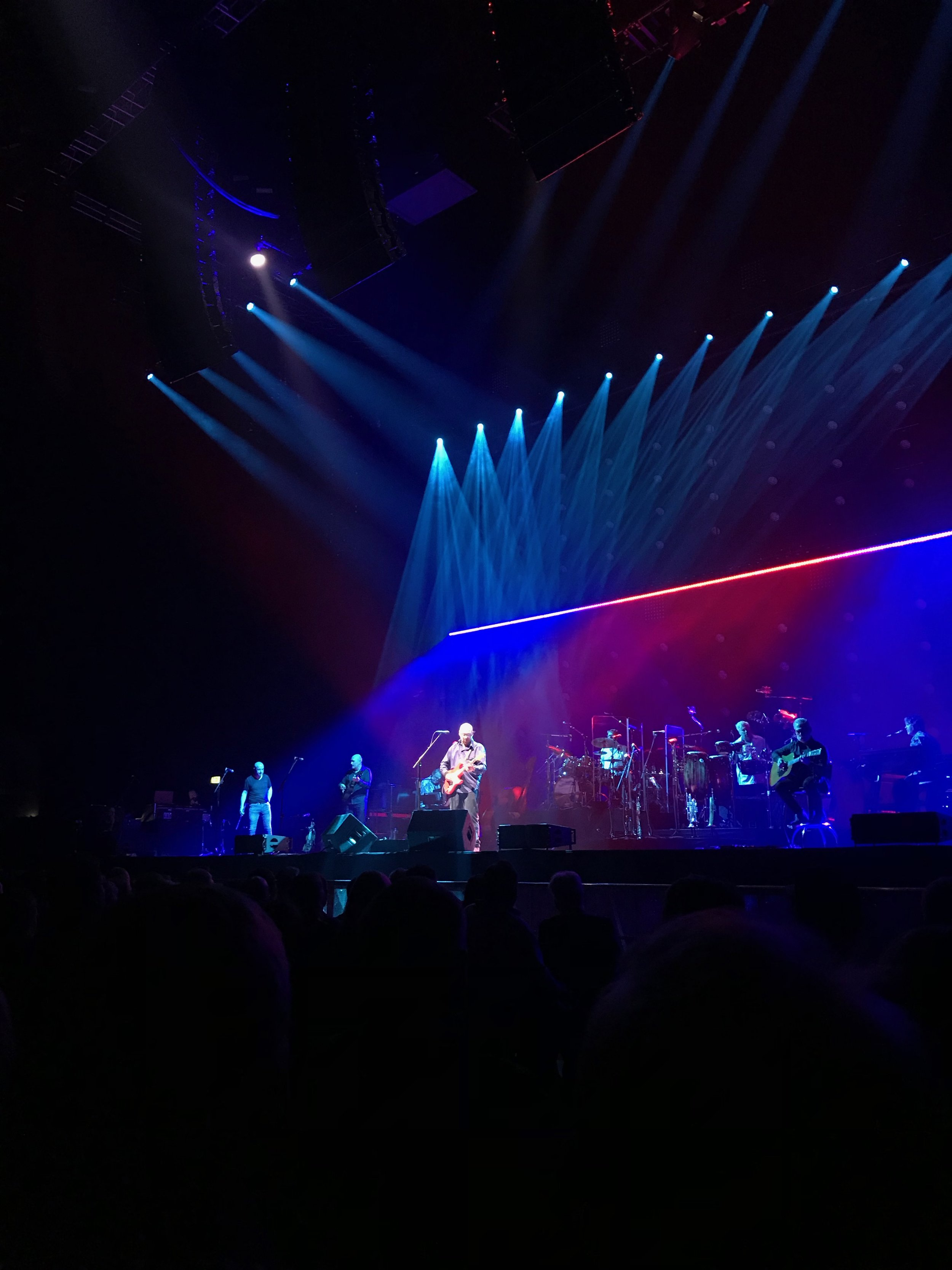 Mark Knopfler getting up under those coloured lights to do his thing..