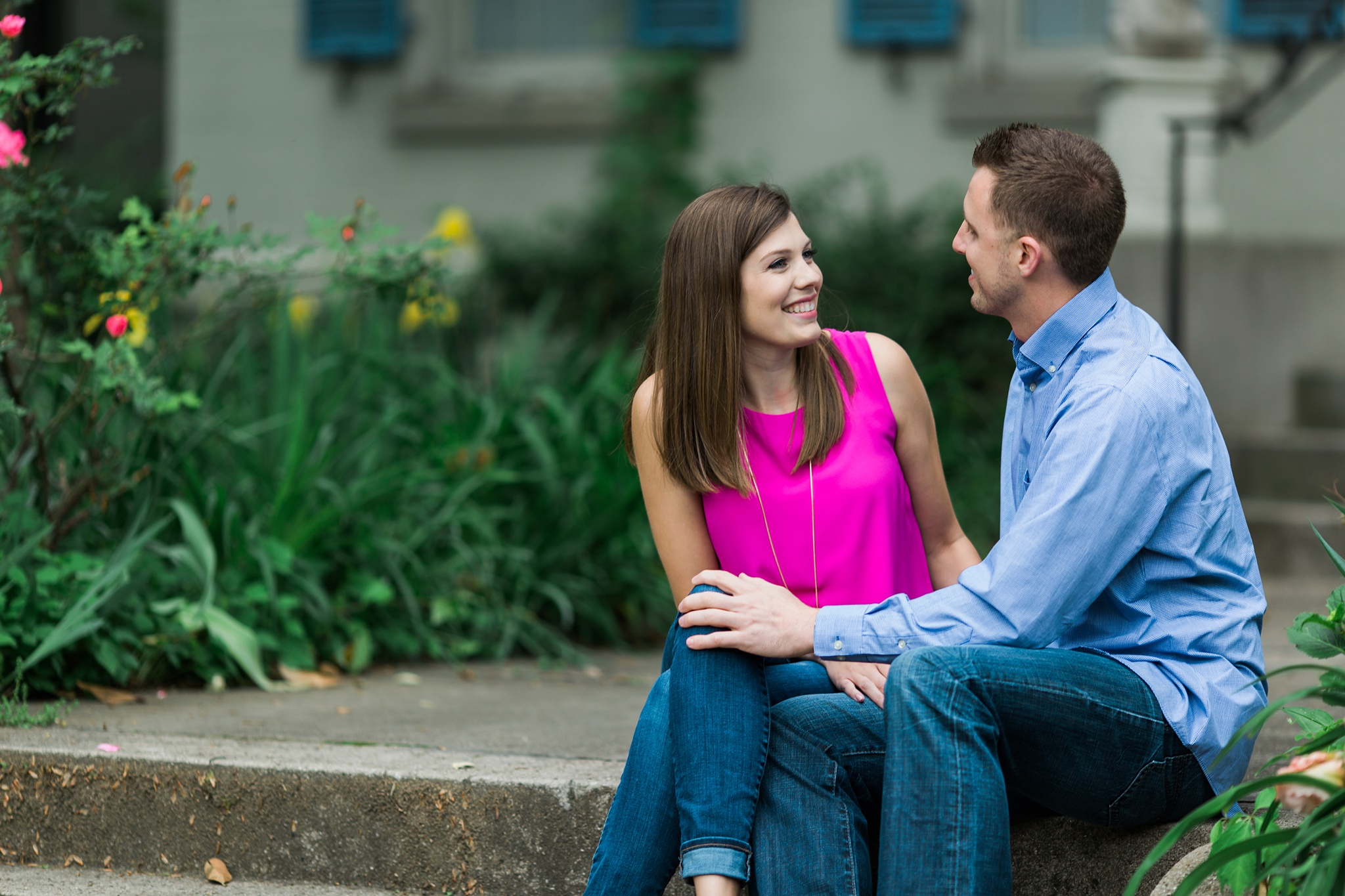 Engaged couple smiling during photos at st james court in Louisville KY