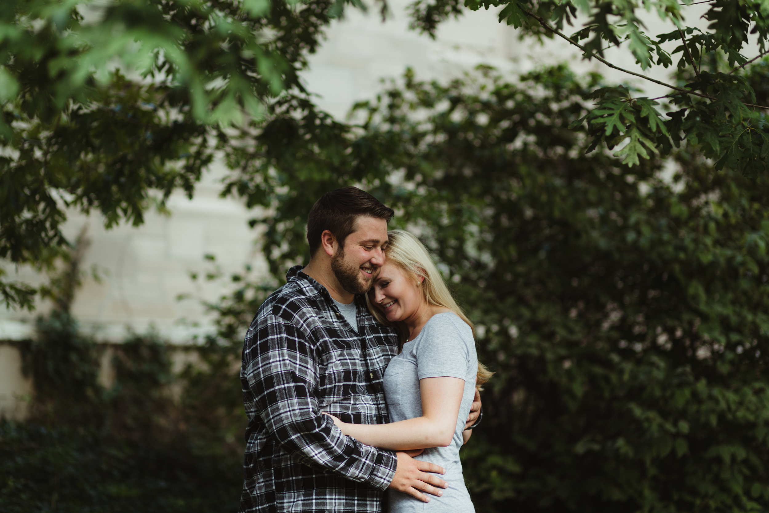 Engagement photos of a smiling couple at University of Evansville Indiana