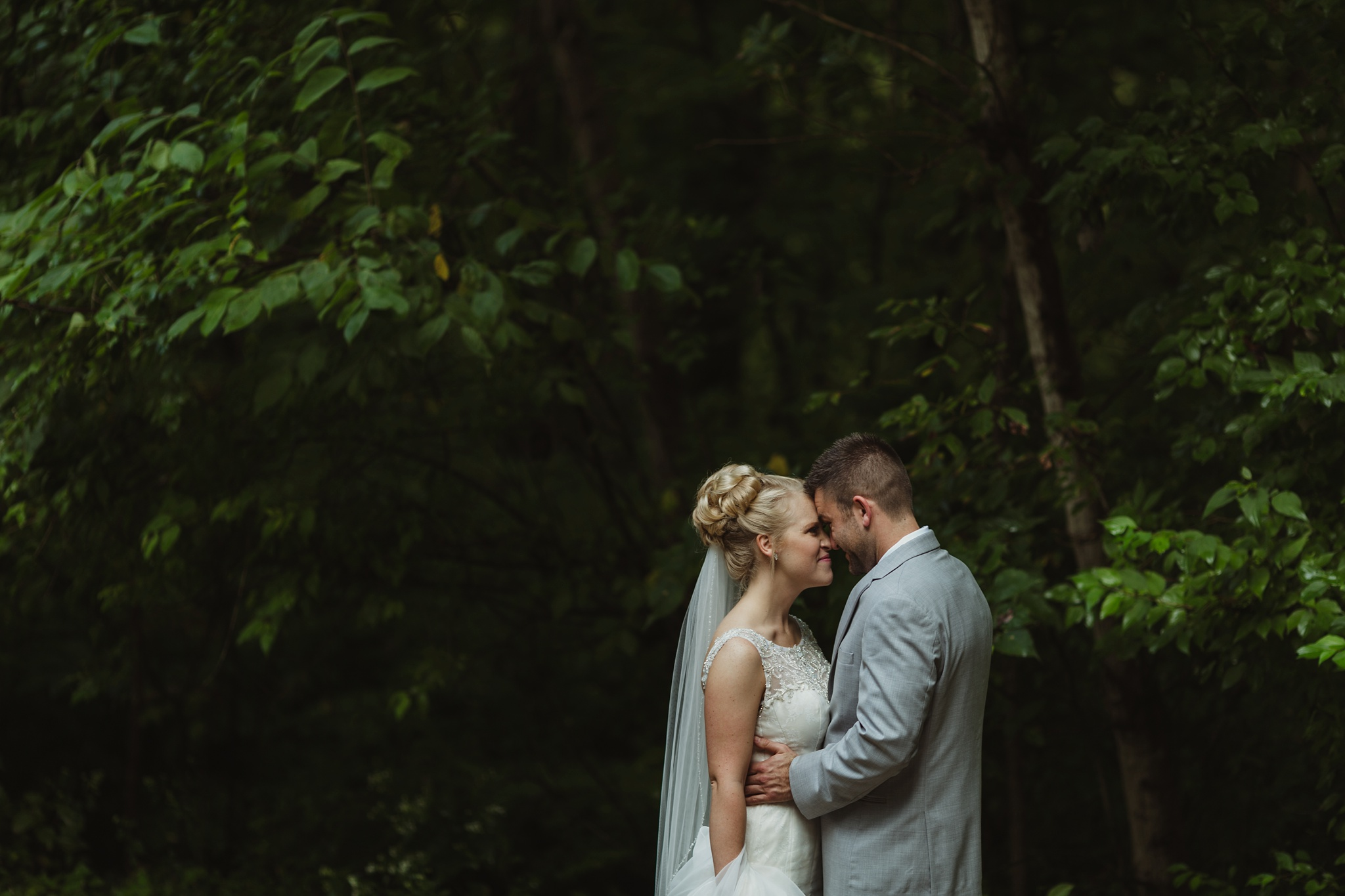 Bride and Groom embrace during first look at spring mill state park