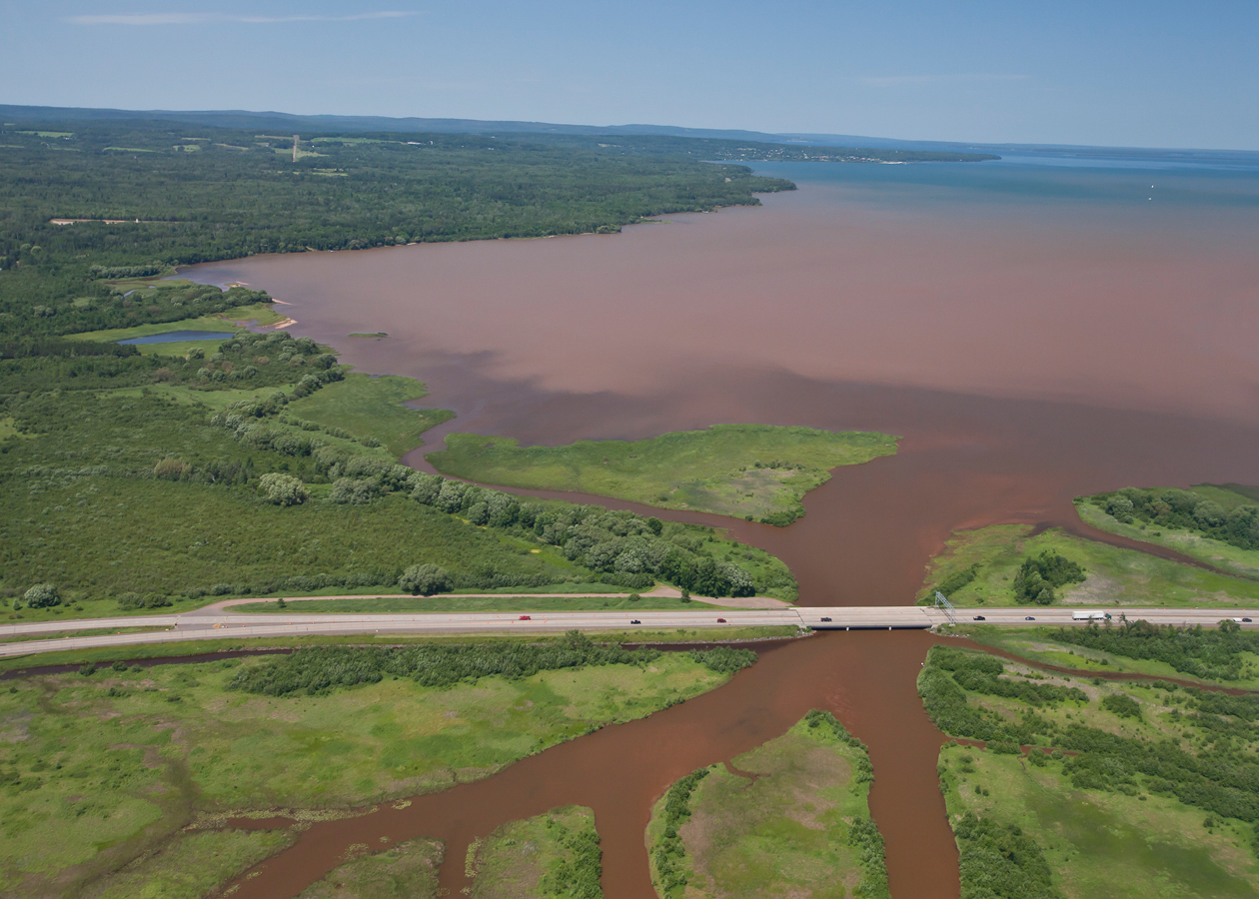Fish Creek emptying sediment and run-off from farms and residences upstream into the Chequamegon Bay in Lake Superior after a heavy rain in 2013.