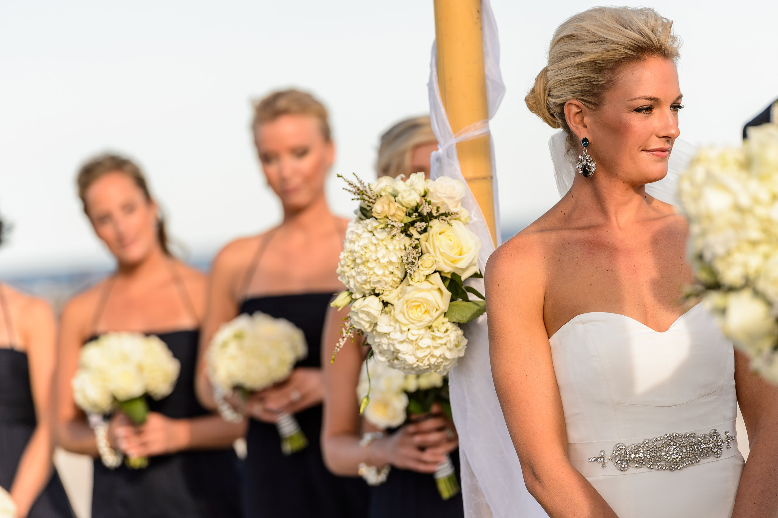 bouquet at altar with bridesmaids.jpg