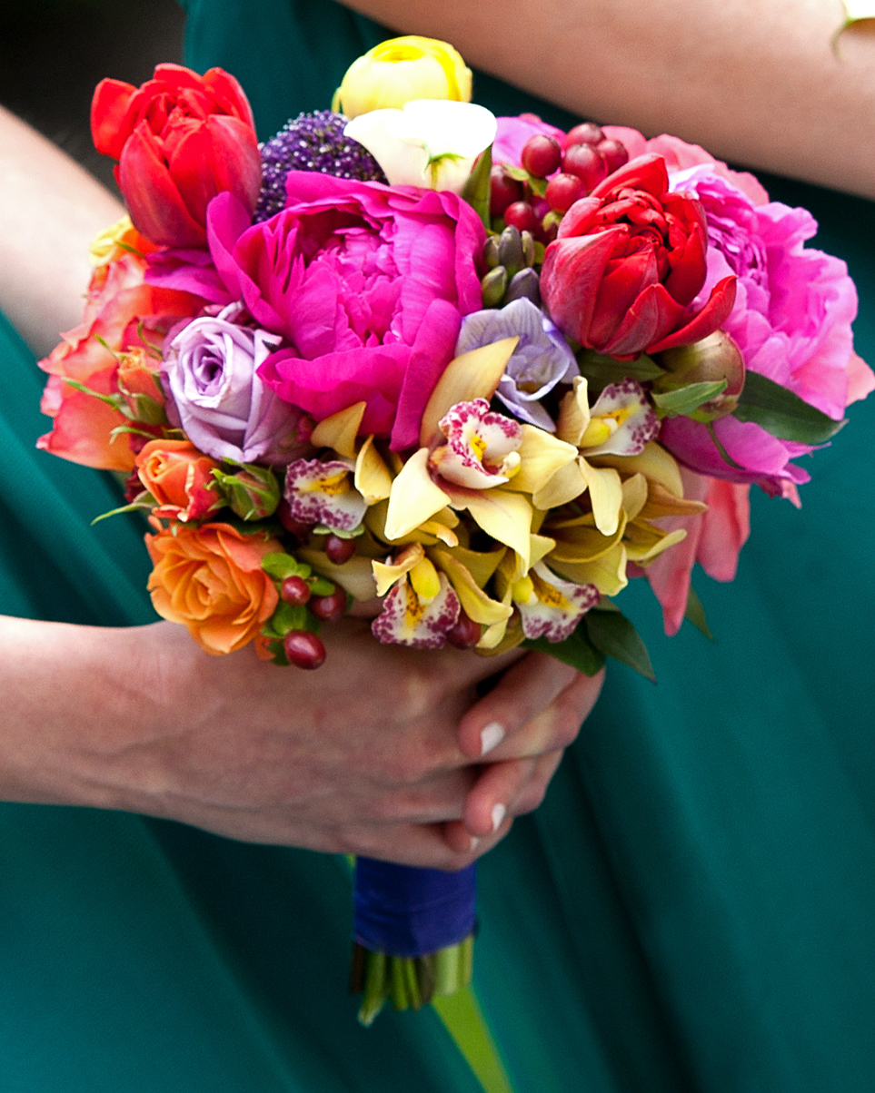 Lush Nosegay (Above) - assortment of bright and vibrant blooms in an elegant hand-tied bouquet