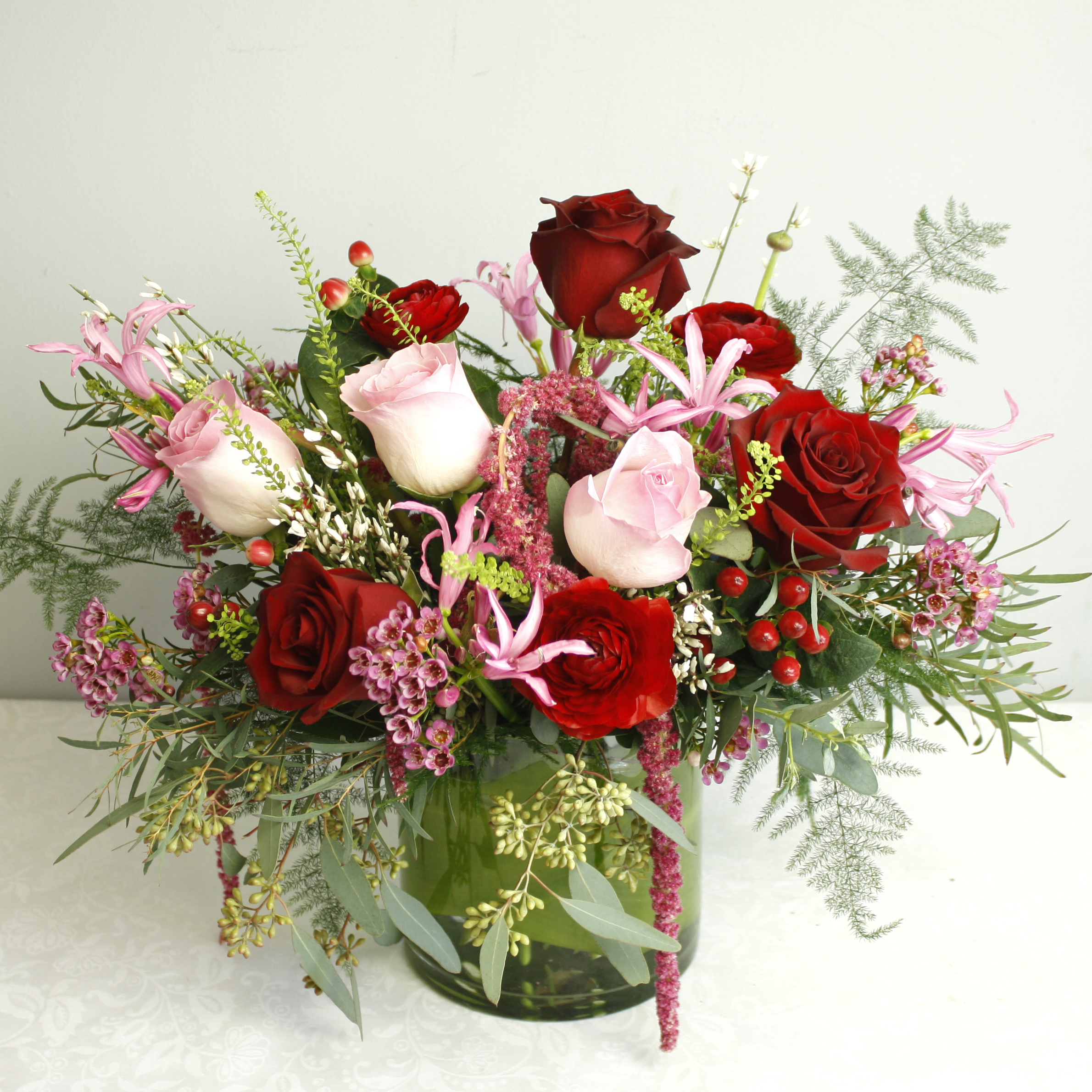 English Manor - styled on vintage english gardens this charming floral piece is perfect for any floral lover! Featuring Roses, Ranunculus, Amaranthus, and more!