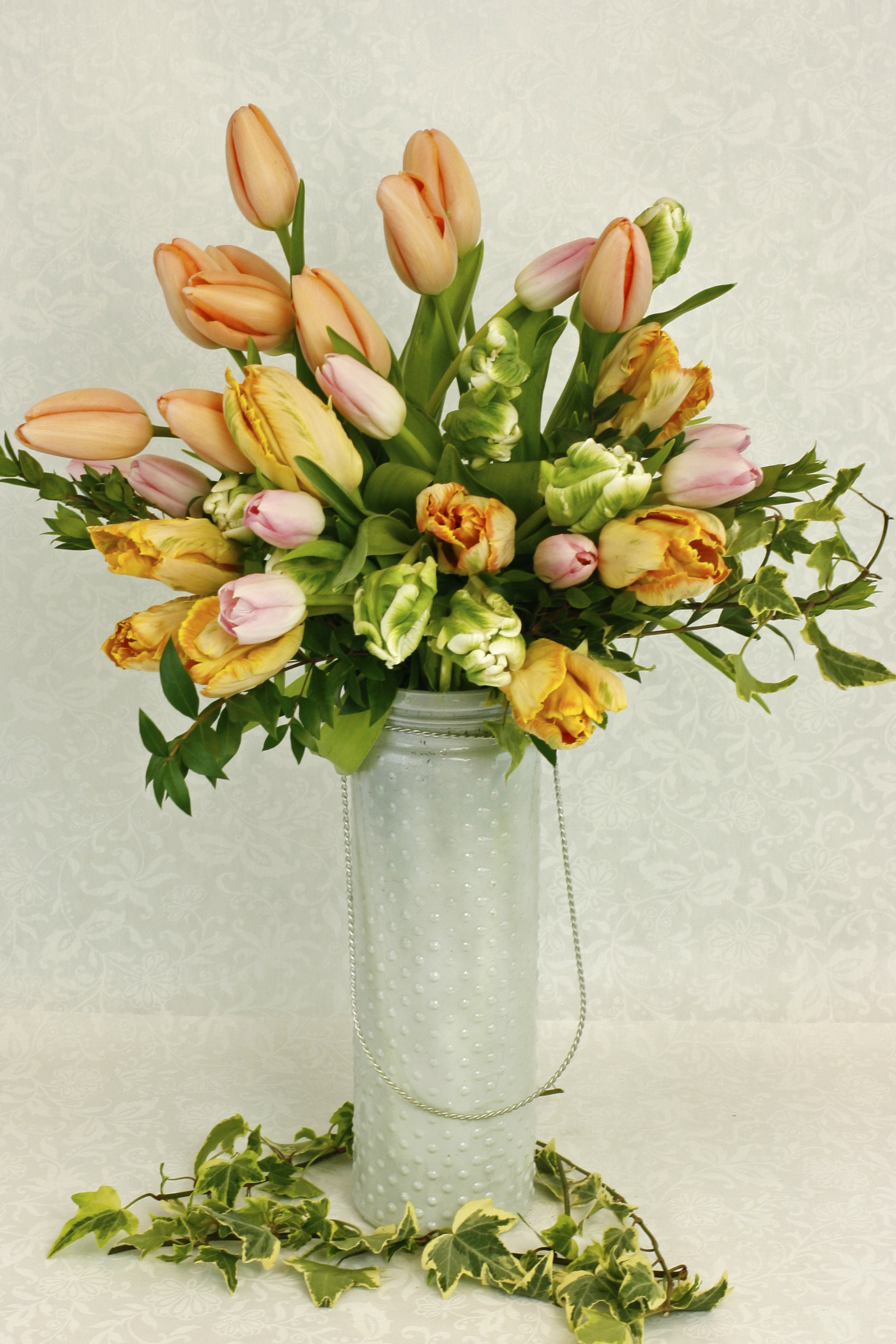 Elegant tulips in a stylish modern container. French Tulips, Parrot Tulips, and more!