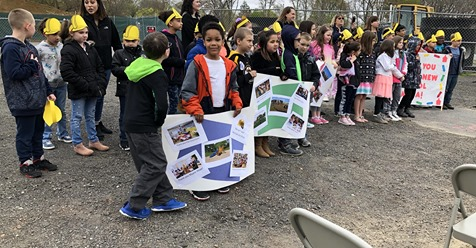 Elementary students took part in the groundbreaking ceremony for the new James L. Mulcahey Elementary School by holding signs and leading the Pledge of Allegiance.  Taunton Gazette photo by Charles Winokoor