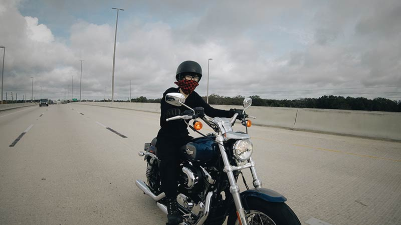 Kojii-Helnwein-on-Harley-Sportster1200-open-face-helmet-800x400.jpg