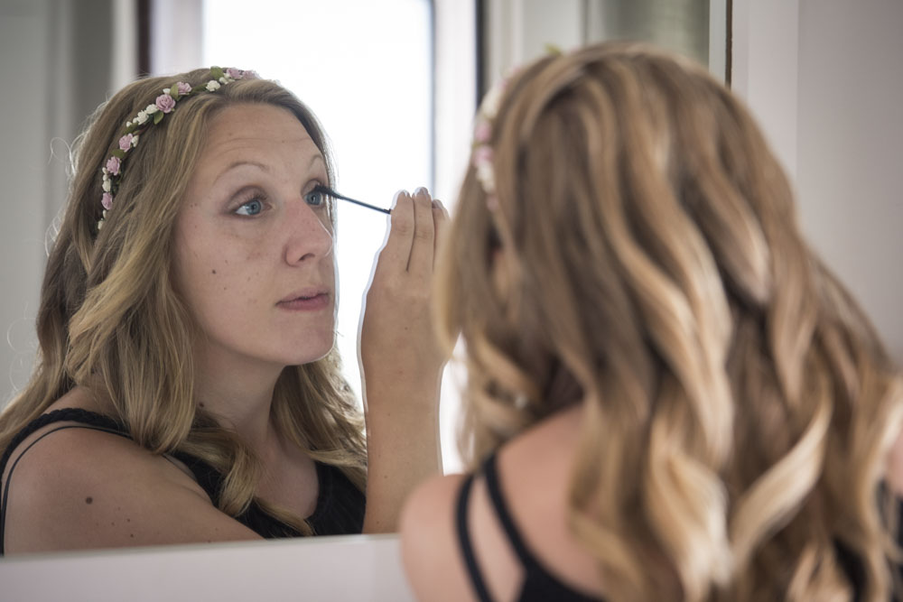 bride putting on make up boho cornwal.jpg