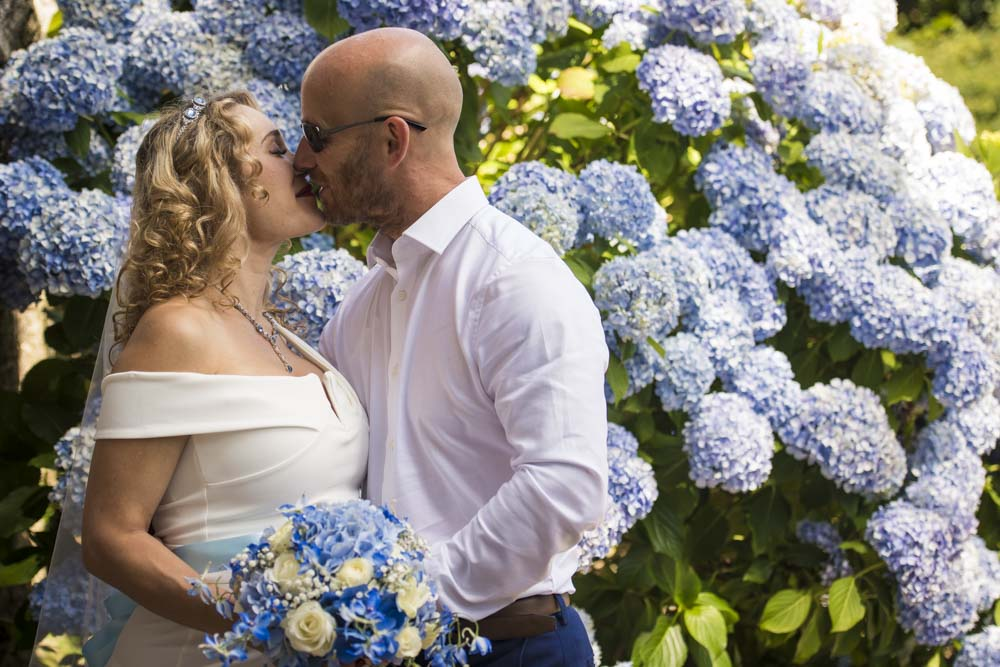 kissing in front of flowers boho cornwall.jpg