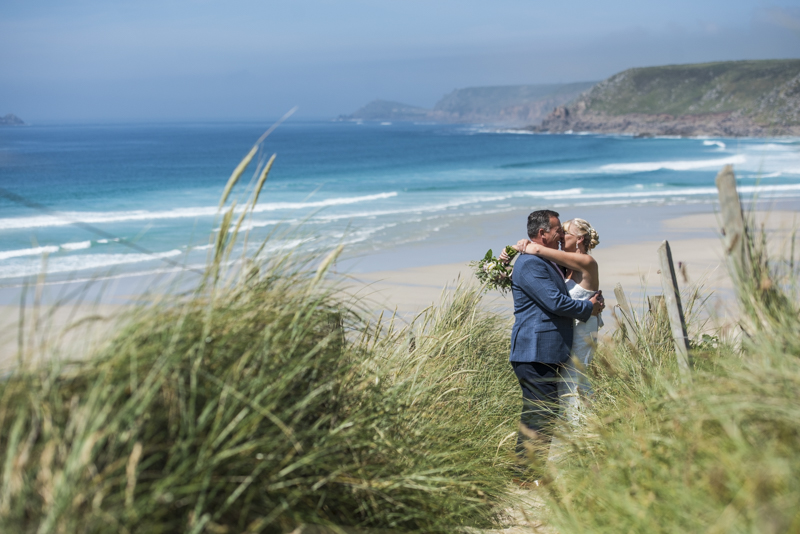 Kissing on the beach at Sennen cove Boho Cornwall