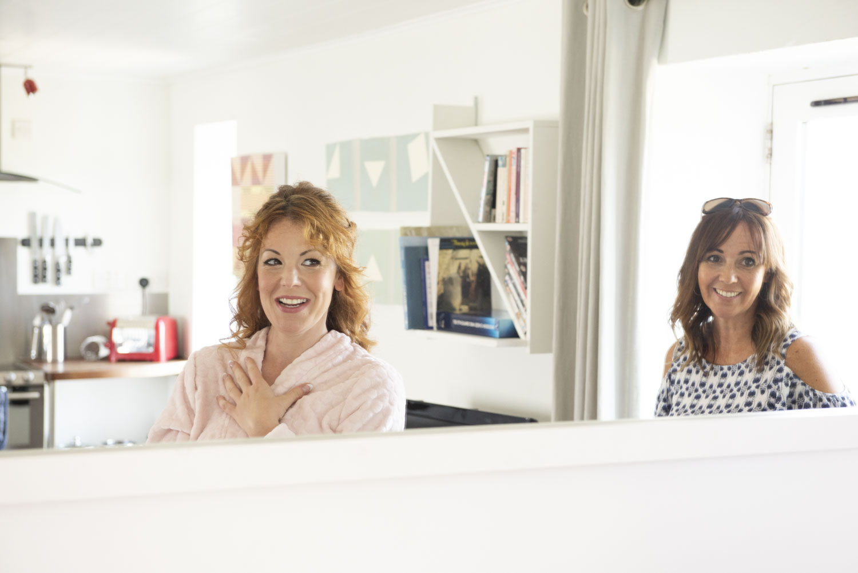 Bride and hairdresser in Mirror