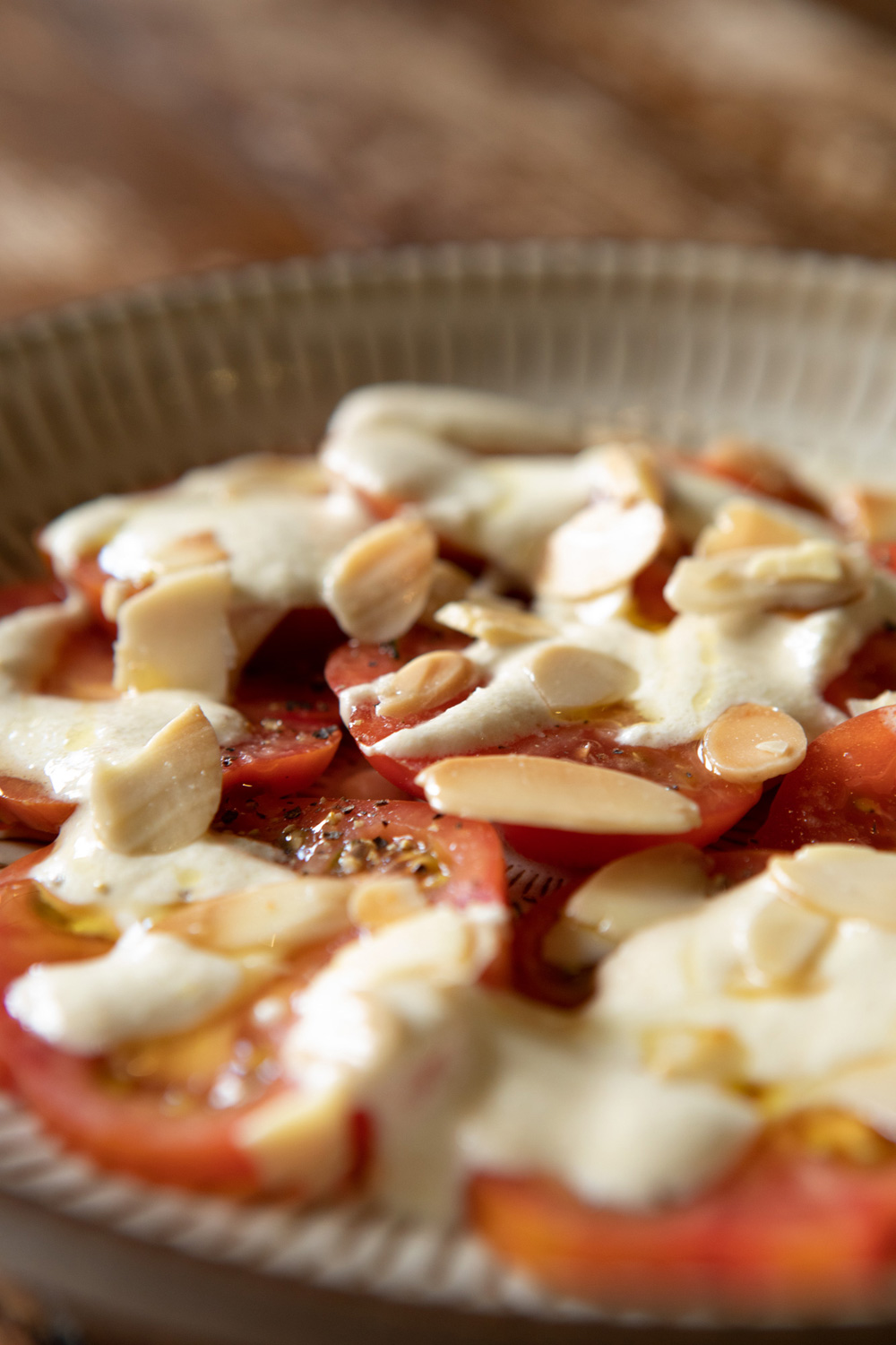 Tomatoes, white almond dressing, oregano