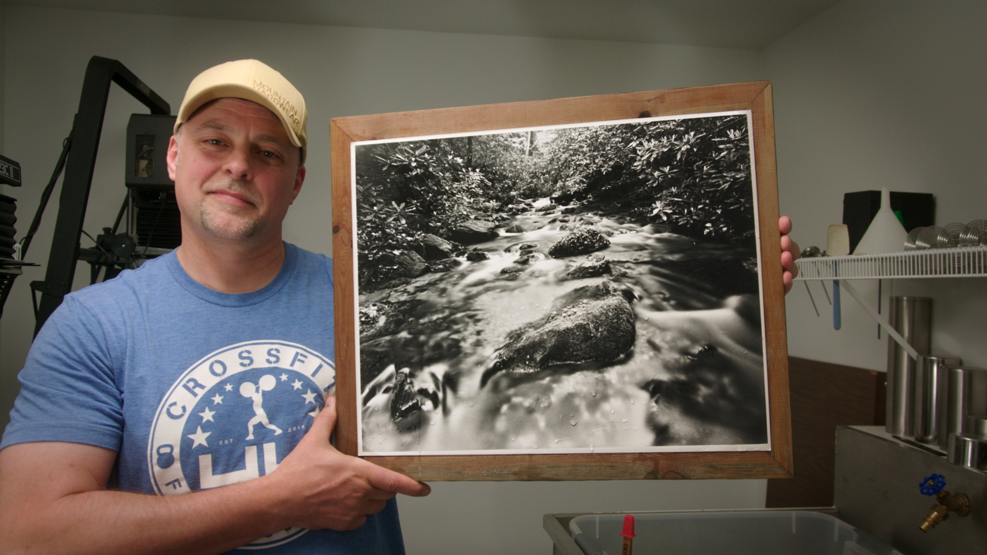 Ronnie shares his results in his darkroom.