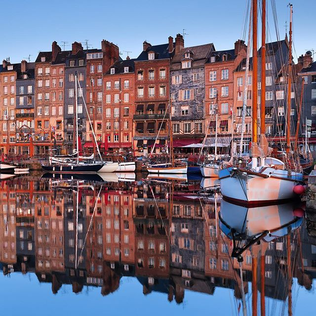 "Honfleur is such a pretty city, especially the old port.  After a few cold mornings with no luck, I had only one morning left to get the image I wanted. Normandy is well-known for it's rainy climate, and I thought I might be out of luck.  Fortunately, the sun came out of the clouds just long enough for me to capture this moment. —————— This shot is part of my new video ""Enchanting France"", which invites you to discover the Hexagone on a road less travelled, but just as captivating. Link in my profile ▶️ . . . . . . . . . . #francefr #visitfrance #travelfrance #instafrance #jaimelafrance #beautifulfrance #topfrancephoto #ig_france #hello_france #visitlafrance @loves_united_france_ @magazinegeo #wanderlust #beautifuldestinations #timelapse @honfleur #visithonfleur #calvados #honfleur #igershonfleur #normandie #normandy #igersnormandie #visitnormandy #normandietourisme #roamtheplanet #stayandwander #wildernessculture #liveoutdoors #discoverearth"