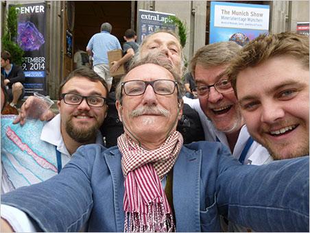Sainte-Marie selfie. From left, Will Larson, Giancarlo Parodi (Muséum national d'Histoire naturelle), unknown (in back), Bill Larson and Carl Larson. Taken at the Sainte-Marie show last summer.