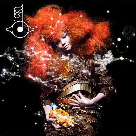 On the cover of  Biophilia  , Björk plucks her bodice with one hand while holding what looks to be Mexican creedite with the other.