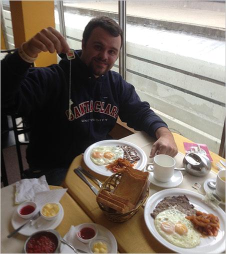 Tea party. After a long flight, Will Larson enjoys an Bolivian breakfast in La Paz. (Photo: Paparazzo)