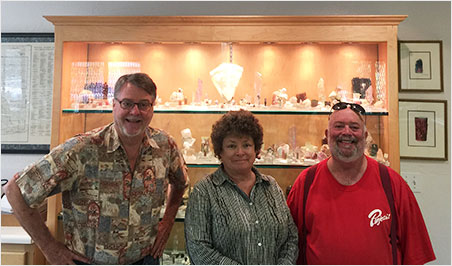 At Pala International's mineral preparation room, with a San Diego County collection behind, Bill Larson, Betty London and David London. Betty chose to have a nice day in Fallbrook as we convoyed to the mines. (Photo: Will Larson)