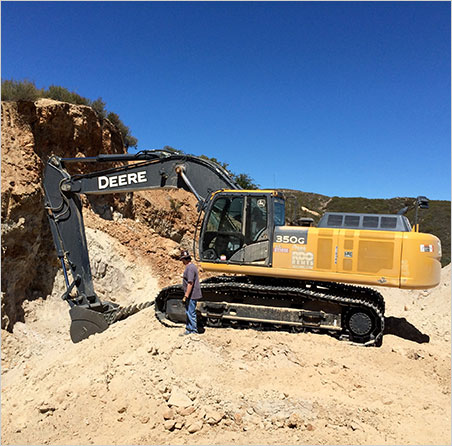 RPL Mining does the heavy lifting at the Mountain Lily Mine. Above, Pala crew member Casey Jones tries to free his toe from the tread of an 80,000-lb. excavator. (We know what's on the iPod in the cab: Carole King .) Photo: Bill Larson)