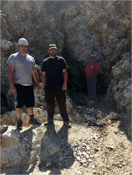 Carl Larson, Kyle Snyder, with David London in back, where he can study the schorl patterns. Note the size of the pegmatite. (Photo: Bill Larson)