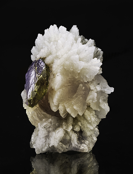 Tanzanite parasite?  Prehnite and tanzanite from Merelani, Tanzania, 5.5 x 4 x 4 cm. Price available upon request. (Photo: Mia Dixon)