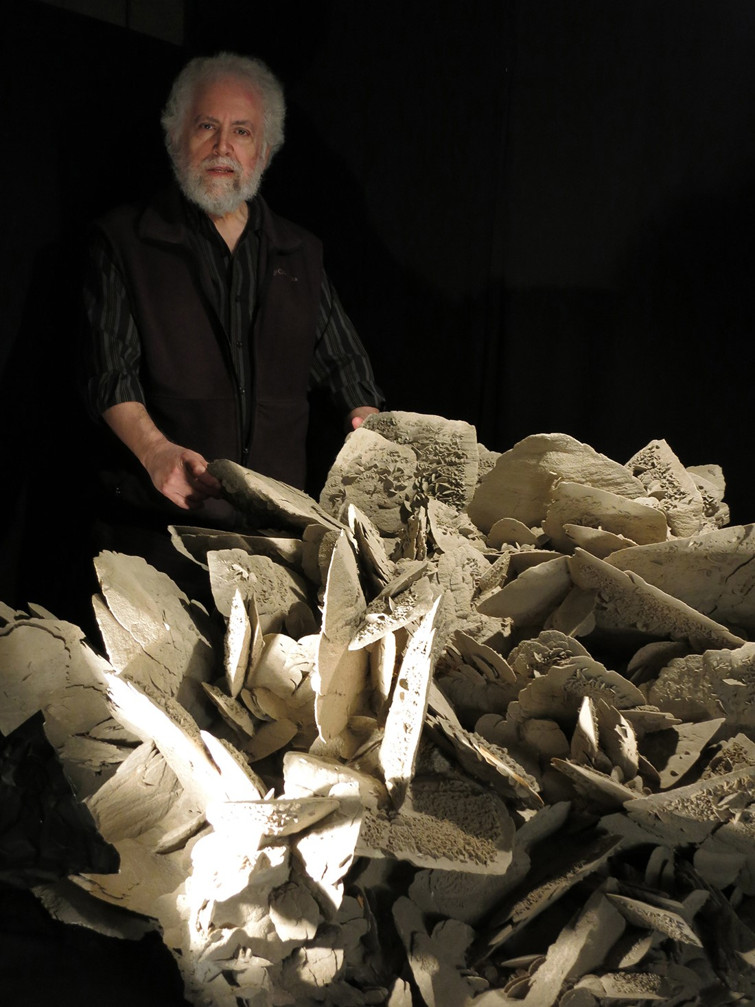 Richard Berger with the selenite rose from his Masterpieces of the Earth Collection. It is one of the massive crystals that will anchor the David Friend Hall. (Photo: Casper Beesley)