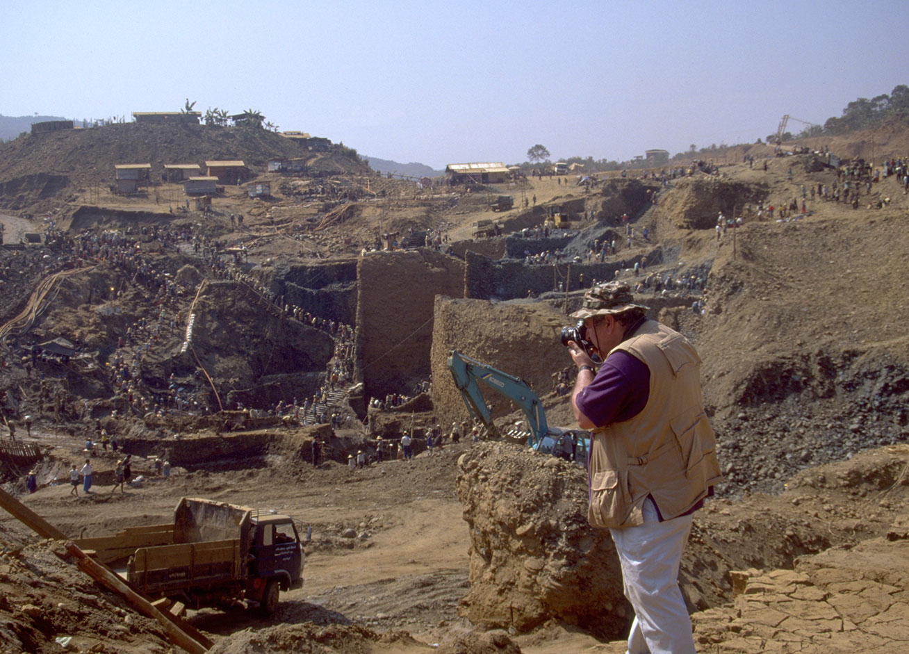 """Fred Ward engaged in his life's work, Hpakangyi jade mine, 1997.  See this   article  on the environmental devastation of jade mining posted on  his Friends of Jade website. For a detailed look at jade mining see """"  Heaven and Hell: The Quest for Jade in Upper Burma  """" by Richard W. Hughes and Fred Ward. (Photo: Richard W. Hughes)"""