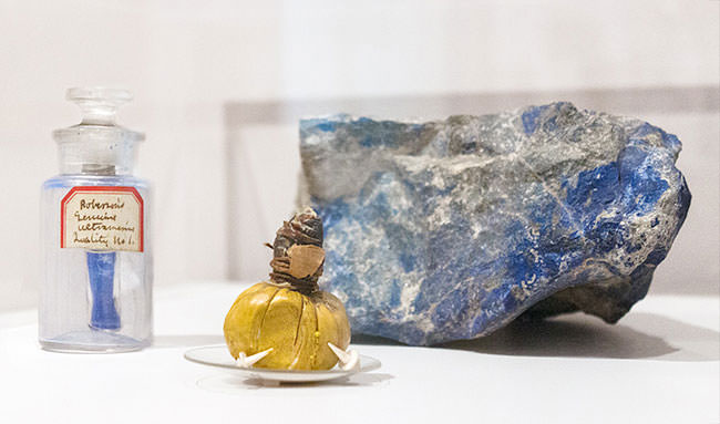Pictured are a chunk of lapis lazuli, a vial of the powdered pigment, and a late 18th- or early 19th-century animal-skin bladder that was used like the modern-day paint tube, sealed with ivory tacks. (Photo courtesy Harvard Art Museums)
